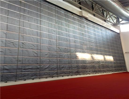 北京新国际展览中心为什么使用江苏济通挡烟垂壁布